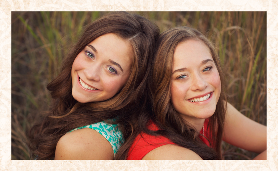 Close-up senior portrait of beautiful twins Madison and McKenna Farren in a field