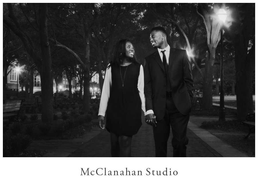 Portrait of Melvin Ejim and Samantha Melvin hitting the down in dress clothes lit by streetlights