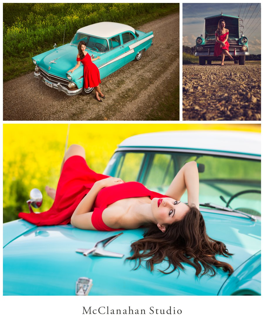 On the hood of a teal ford car in a red dress. Epic, sassy, stylish senior portraits with yellow flowers and blue skies by McClanahan Studio.