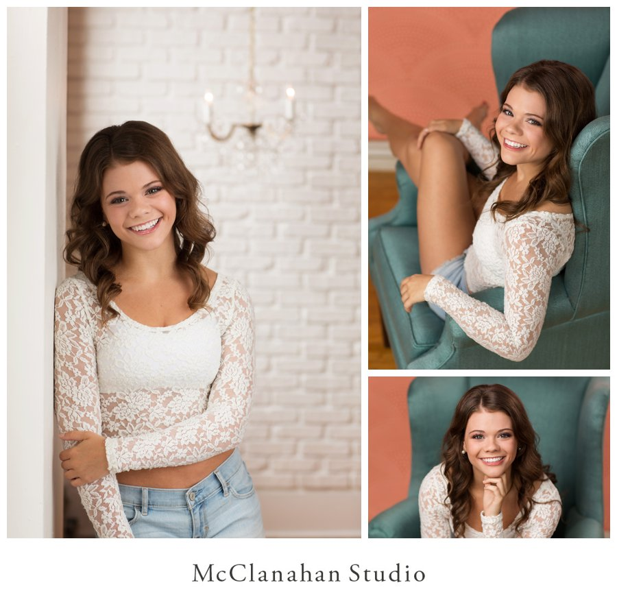 Waukee high school senior photos taken at McClanahan Studio in Ames. Maddie's white lace top looks great against white brick and a chandelier.