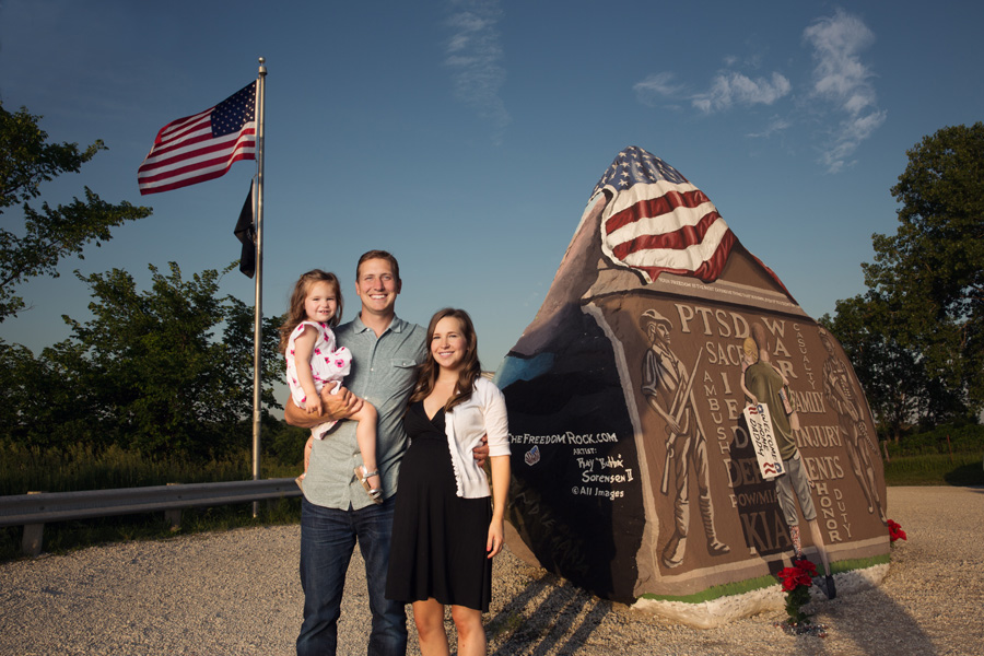 Family portrait of Maria, Bubba and Indie Sorensen in front of The Freedom Rock 2014 in Greenfield, Iowa.