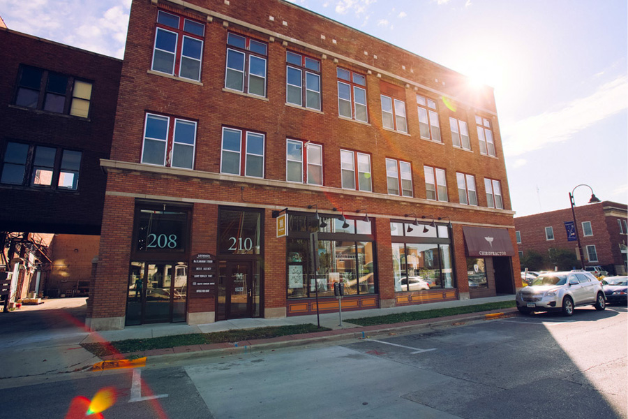 McClanahan Studio, 210 5th St Ames IA, from the exterior with a sun flare peeking over the corner of the building