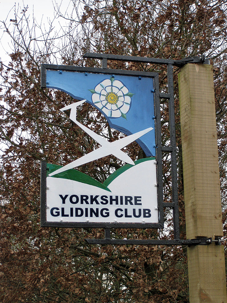 Sign for the Yorkshire Gliding Club. If memory serves, the sign was different in 1987. © Copyright Pauline E and licensed for reuse under the Creative Commons Licence