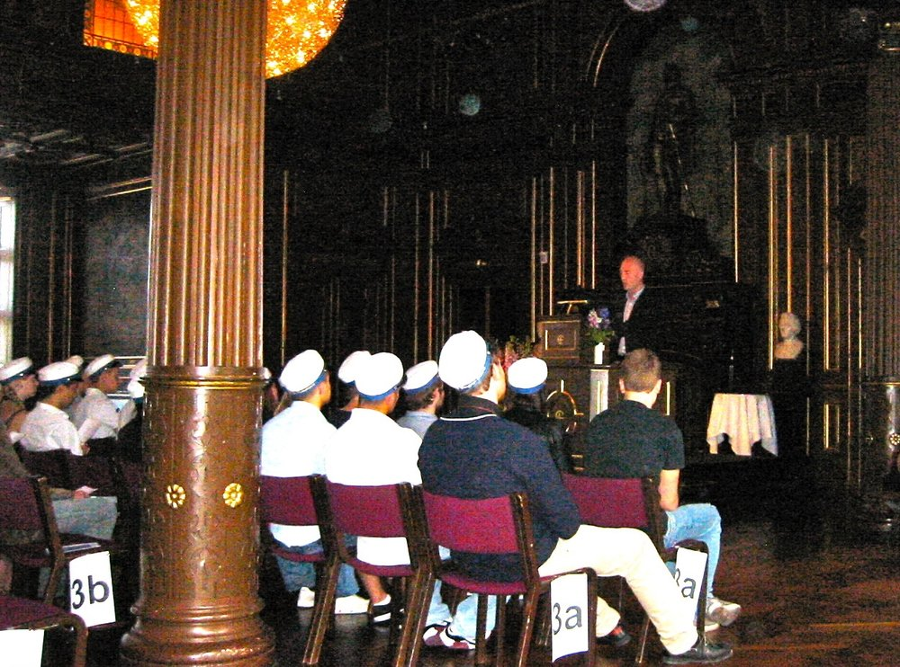 Mickey Beyer-Clausen delivering the commencement speech to graduating students of Niels Brock in 2010