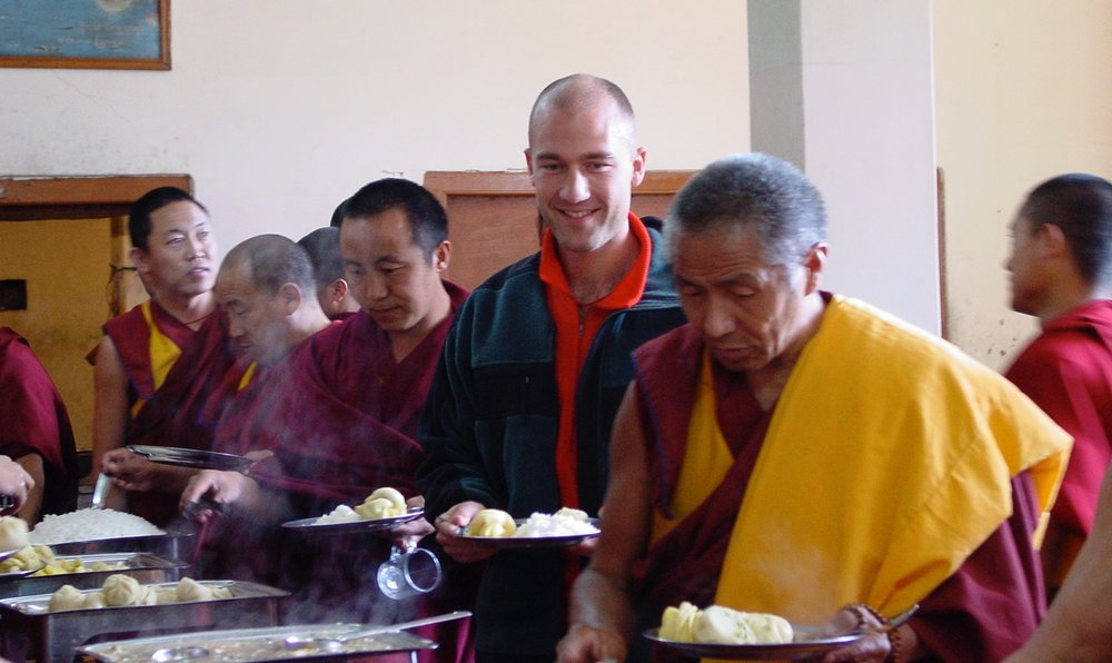 Mickey Beyer-Clausen eating lunch with the monks at Dalai Lama's Namgyal Monastery