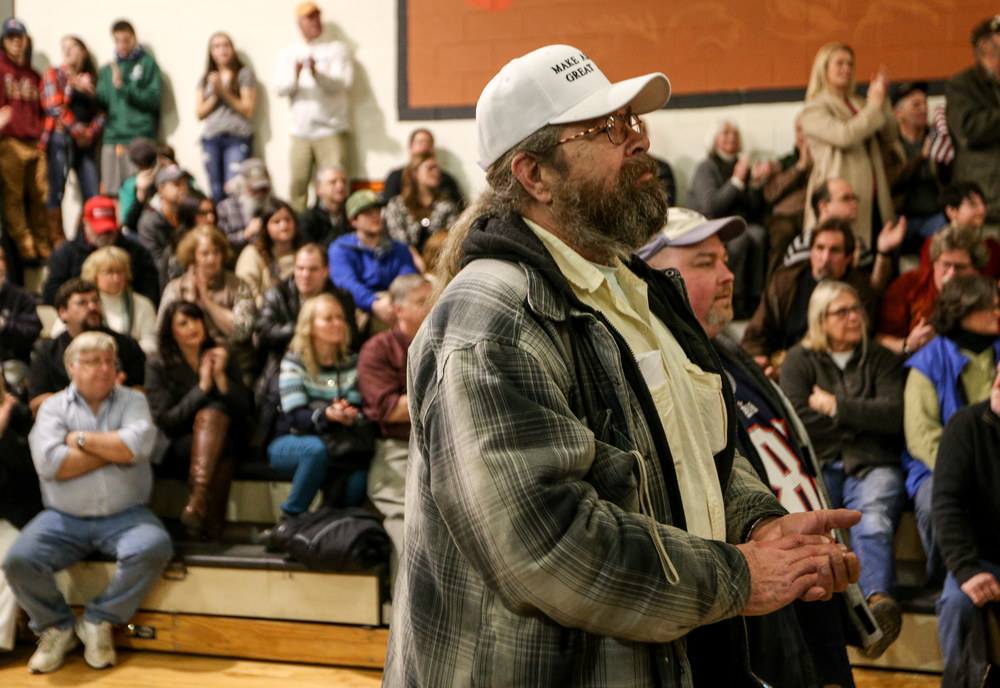 Chris Hanson of South Barris, Maine listens to U.S. presidential candidate Donald Trump speak during aat a Donald J. Trump for President Rally at Farmington High School, 40 Thayer Dr., Farmington, NH on Jan. 26, 2016.