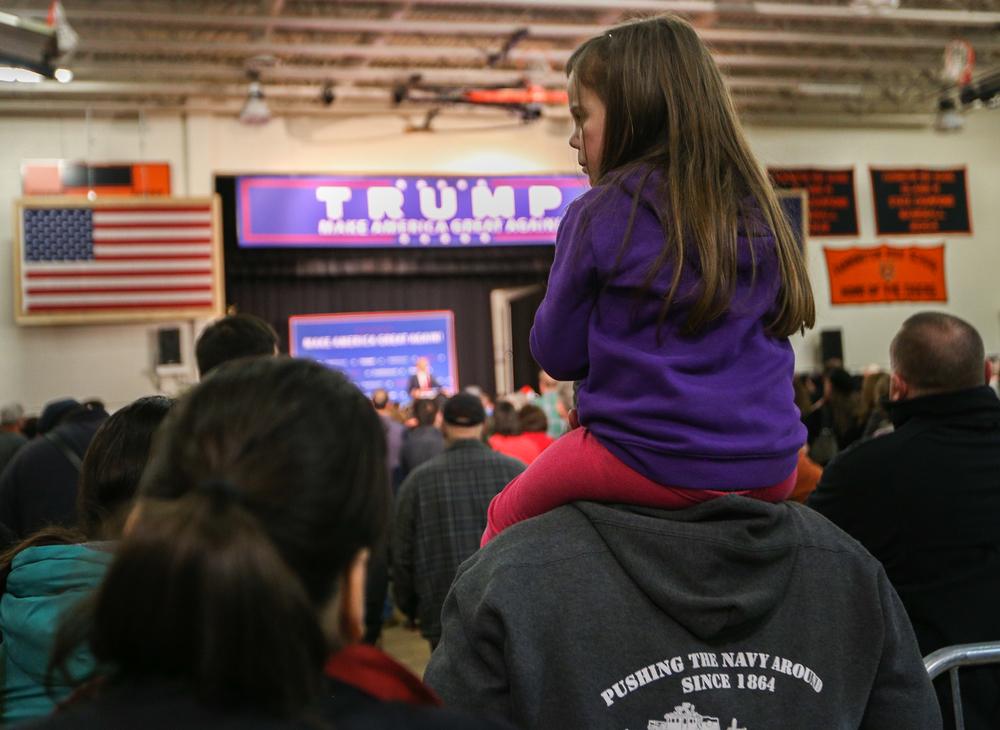 A child watches U.S. presidential candidate Donald Trump's speech  during a Donald J. Trump for President Rally at Farmington High School, 40 Thayer Dr., Farmington, NH on Jan. 26, 2016.