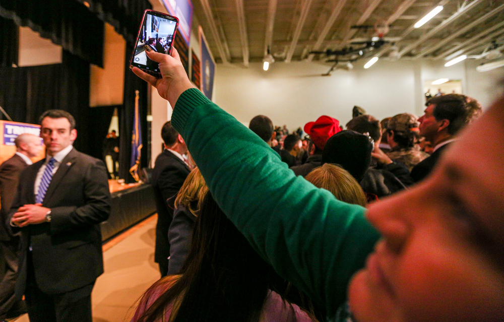 An attendee takes a photo of Donald Trump as he leaves a Donald J. Trump for President Rally at Farmington High School, 40 Thayer Dr., Farmington, NH on Jan. 26, 2016.