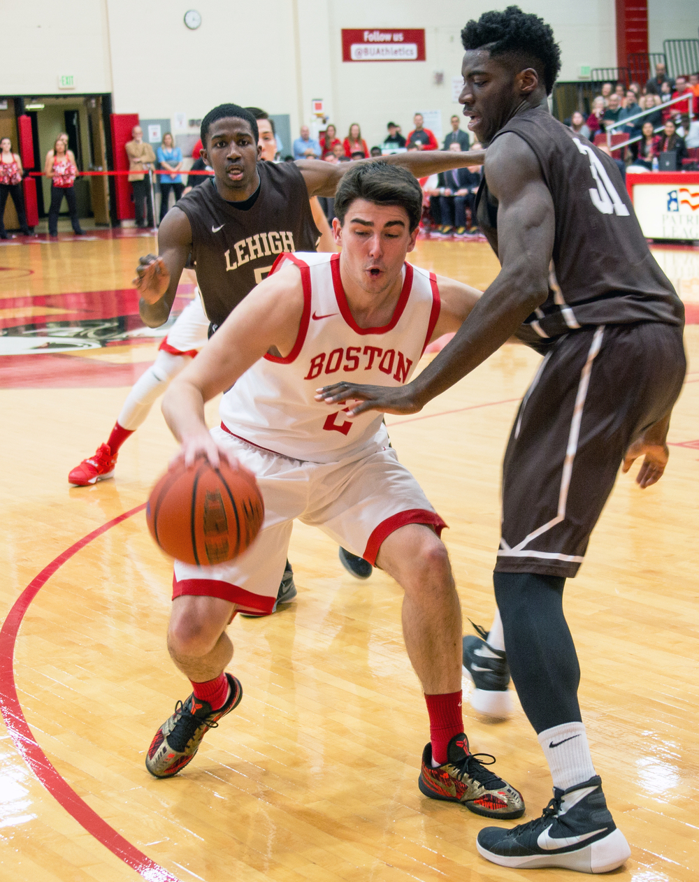 Boston University men's basketball senior guard John Papale dribbles past opponents from Lehigh University's during a game at Boston University's Case Gym in Boston Mass., on Jan. 31, 2016. Papale scored in the game's last 30 seconds to bring the score to 75-73.