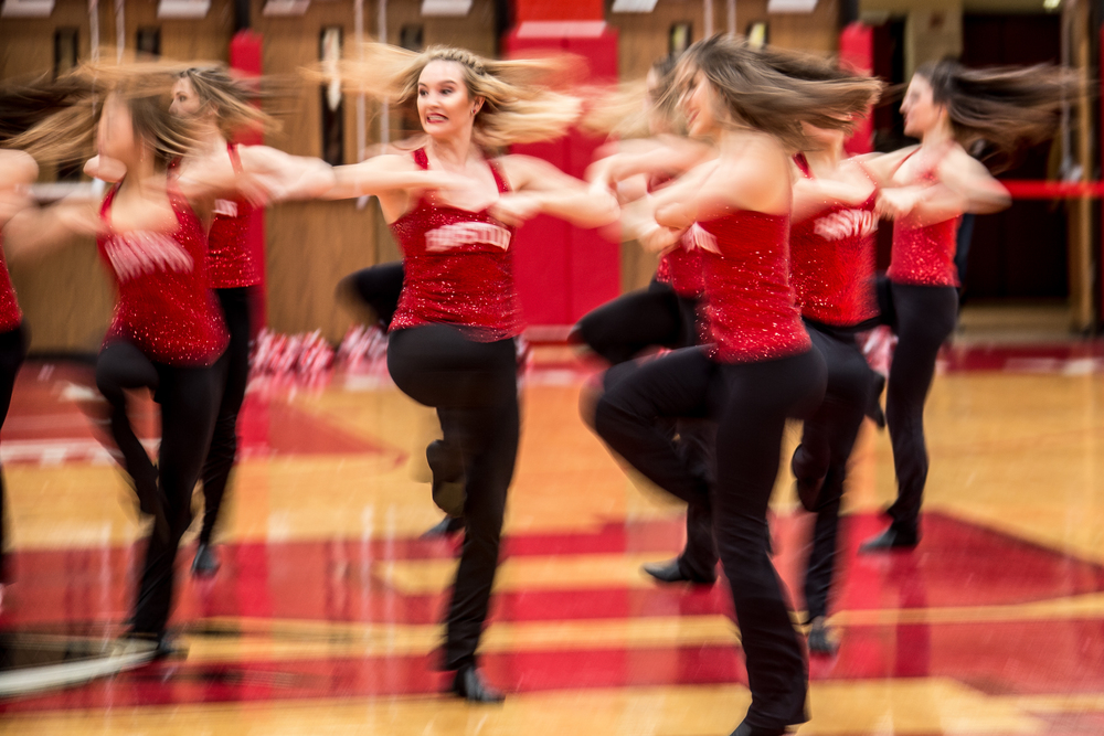 Boston University Dance Team member Andy Elizabeth (center) performs a routine with her team at halftime during a Boston University vs. Lehigh University men's basketball game in Boston University's Case Gym in Boston Mass., on  Jan. 31, 2016 . At halftime Lehigh University had the lead with a score 39-35, but Boston University came back to win with a final score of 75-73.