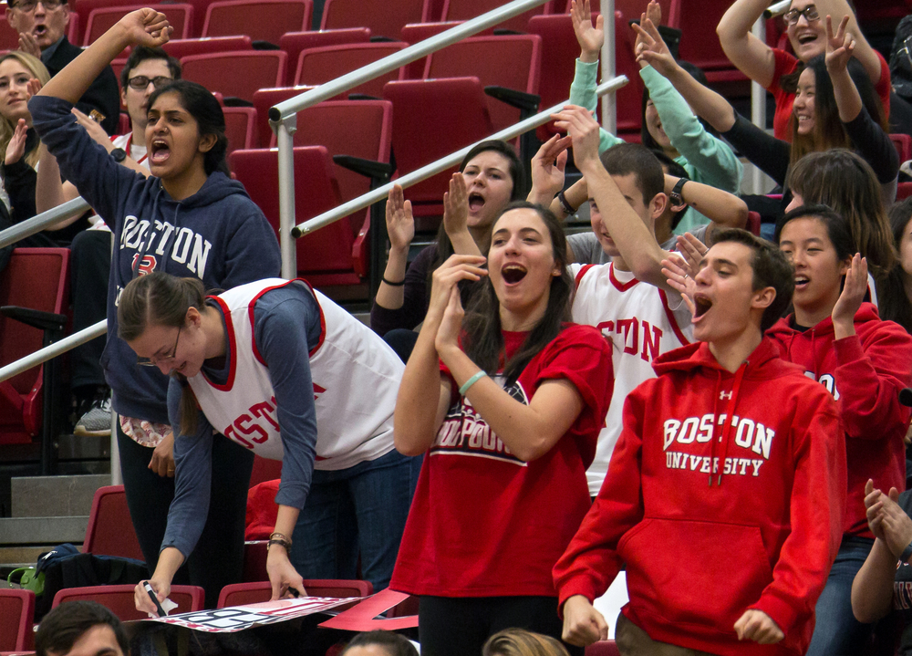 Boston University students (from left) Anvita Hanchate, Catherine Lanyon, Becca Matta, and Ben Fisher react after BU's men's basketball team scores in a game against Lehigh on Sunday, January 31, 2016 in the Case Gym in Boston, Mass. BU won 75-31.