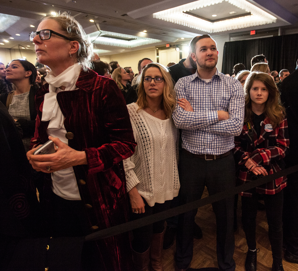 Manchester, NH,Feb. 9, 2016 - (From right) Emma Sheehan of Manchester, Brandon Castle of Albany NY, Chere Choppa of Albany NY, and Ann Lane of Durham NH, wait for primary voting results to come in at Marco Rubio's New Hampshire Primary event at the Radisson Hotel. Photo by Alexandra Wimley