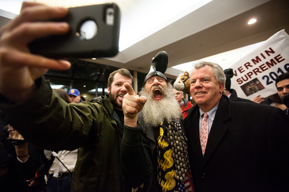 Manchester, NH, Feb. 9, 2016 - Fans take a selfie with U.S. presidential candidate, performance artist and activist Vermin Love Supreme outside of Marco Rubio's New Hampshire Primary watch party at the Radisson Hotel. Photo by Alexandra Wimley