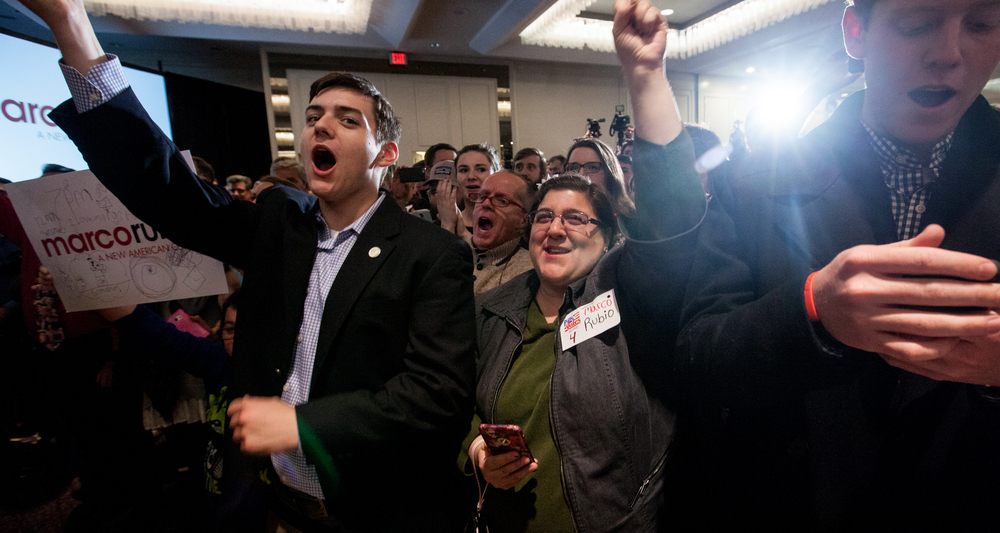 Manchester, NH, Feb. 9, 2016 – Connor Price of Dallas TX (left), and Joanne Macheste of Manchester (center), cheer as Senator Marco Rubio takes the stage at his New Hampshire Primary watch party at the Radisson Hotel. Photo by Alexandra Wimley