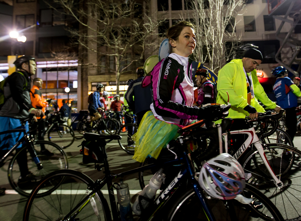 Carrie Nielsen, of Mansfield, Mass., walks her bike after completing the Midnight Marathon Bike Ride, which begins at midnight on April 18 in Hopkington, Mass., and traverses the route of the Boston Marathon.