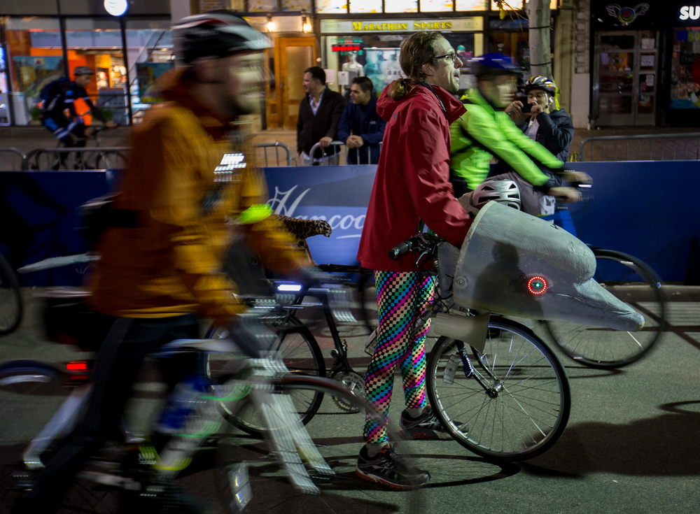 Aleks Zosul pauses with his bike, inspired by his work studying hearing in marine mammals like dolphins, after completing the Midnight Marathon Bike Ride, which begins at midnight on April 18 in Hopkington, Mass., and traverses the route of the Boston Marathon.