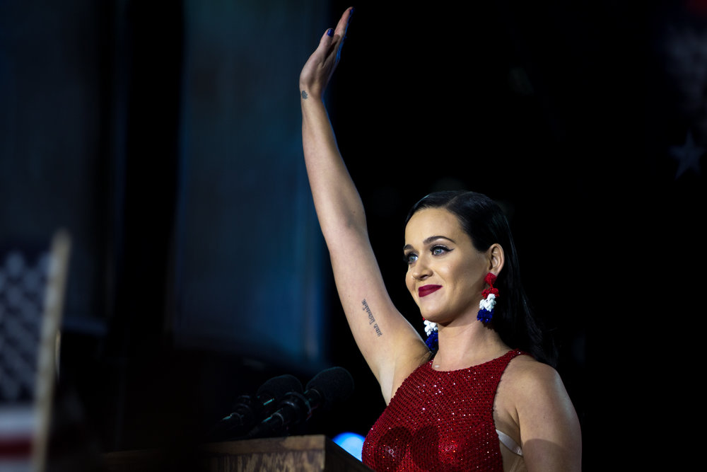 "Singer-songwriter Katy Perry addresses the audience outside the Jacob K. Javits center, Nov. 8, 2016. Hillary Clinton's Election Day Event took place mainly inside the venue, but speakers took the stage at a block party event open to the public. Perry said her parents voted for Trump. ""But you know what? We will still all be sitting at the same table for Thanksgiving,"" she said."