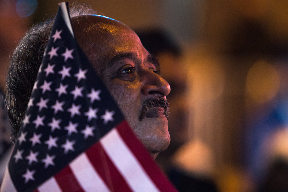 Arpan Patel, an immigrant from India, watches the results come in on the big screen television outside the Jacob K. Javits Convention Center, Nov. 8, 2016.