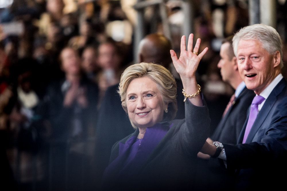 "Hillary and Bill Clinton wave to onlookers while leaving the New Yorker Hotel where she made her concession speech to Donald Trump Wednesday afternoon, Nov. 9, 2016. During the speech Clinton said, ""This loss hurts, but please never stop believing that fighting for what's right is worth it."""