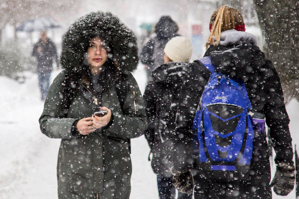 Students walk through heavy snow on Commonwealth Ave., in Boston, Dec. 17, 2016 during the first heavy snow of the season.