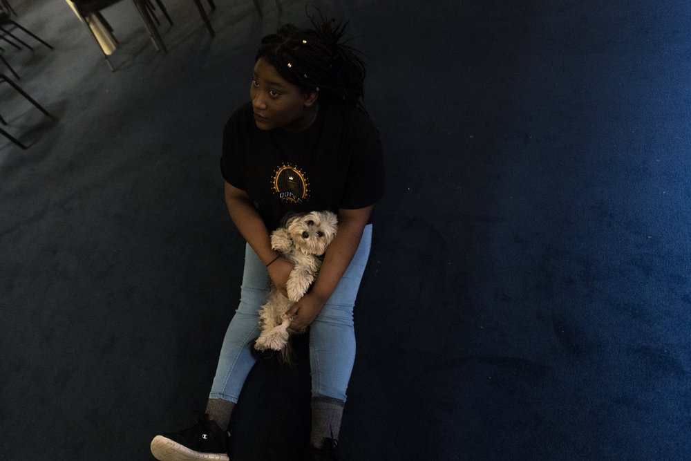 Andrine holds a dog at Cheap Seats in Cambridge, Mass., March 18.