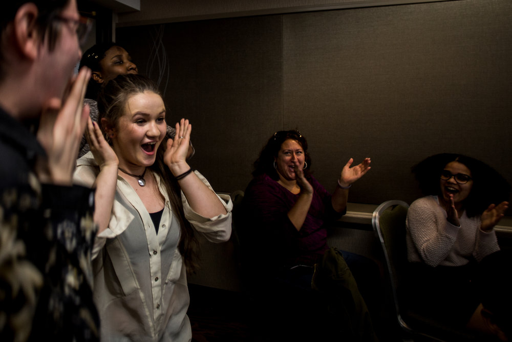 Books of Hope team members react after hearing that their poem received a perfect score during Louder Than a Bomb April 8 in Boston. The team will go on to the final round of Louder Than a Bomb May 6.