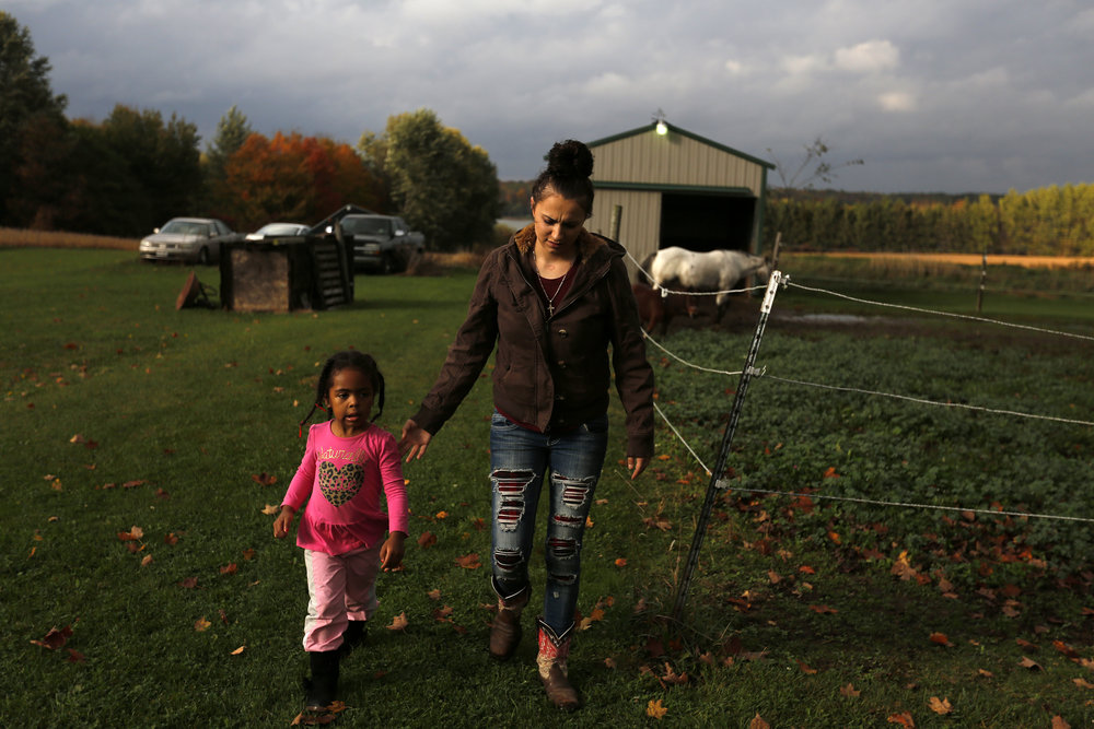 Moriah Rogowski lives in Green Bay but returns home to Mosinee to see her family and spend time on her family's property where she grew up. On a weekend trip in October, Rogowski took a friend's daughter Jehzelle Comic, 3, to ride a pony.