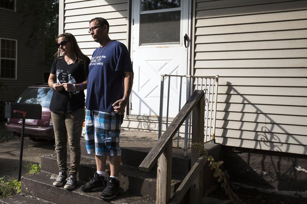 Palmieri and Lopez stand on their porch to say goodbye to friends from Narcotics Anonymous.