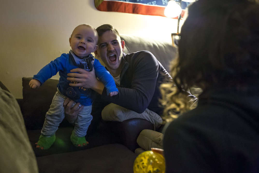 Tommy Casper plays with his nephew Owen Fritsch as his sister Carly Fritsch looks on in his home in Neenah, Thursday, December 7, 2017. Casper often spends time with his sister, who is also a recovering addict, and nephew after work.