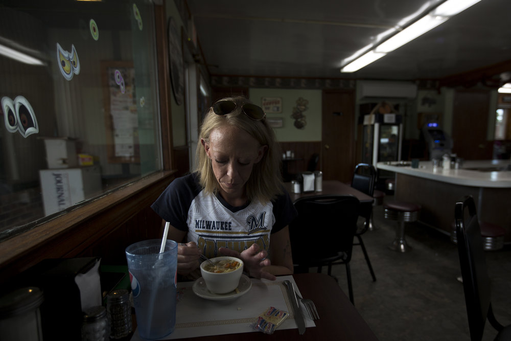 Jennifer Solis eats lunch at South Point Restaurant in Stevens Point, October 9, 2017. Solis lives at the Salvation Army in Stevens Point and works as a roofer when the weather allows. She hopes to go back to school for interior design.