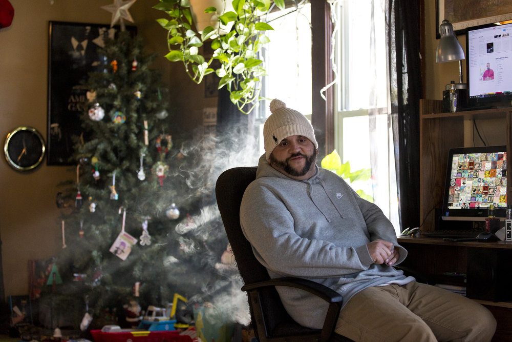 Nathan Scheer talks to family members and smokes an electronic cigarette in his home in Fond du Lac, Wis., December 26, 2017. Scheer became addicted to pain pills after a car accident. When doctors stopped prescribing it to him and pills became too expensive, Scheer tried heroin instead.