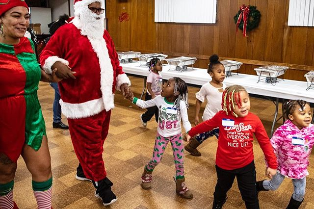 A team of delegates welcomes Santa Clause, of the North Pole, to the Step in the Right Direction Christmas party with New Life Ministries tonight in West Mifflin. (Alexandra Wimley/Post-Gazette) #christmas #santaclaus