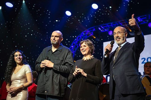 Governor Tom Wolf, right, and Lieutenant Governor John Fetterman, with their wives Gisele and Frances, greet their supporters at their inauguration party tonight in Harrisburg. There were performers with Pennsylvania roots throughout the night and lots of dancing. (Alexandra Wimley/Post-Gazette)