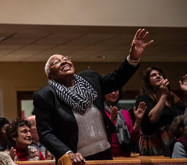 Marcia Donnell, of the Hill District, reacts after a performance in the Let Freedom Sing concert celebrating Dr. Martin Luther King, Jr.'s life tonight at Ebenezer Baptist Church in the Hill District. Donnell has been a member of the church for 55 years, she said. The evening features multiple guest choirs and a dance performance from the D.A.N.A. Movement Ensemble. (Alexandra Wimley/Post-Gazette) #martinlutherkingjr #mlkday #baptist #church #choir #pittsburgh