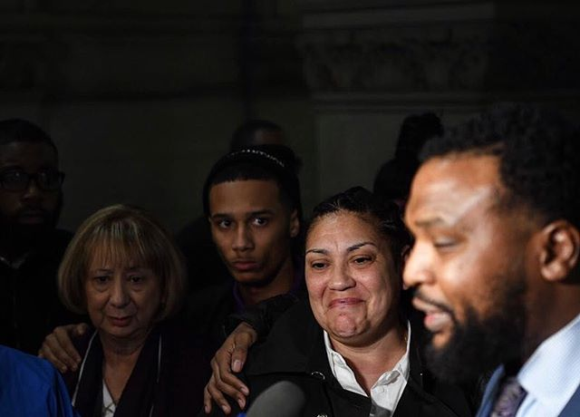 "Michelle Kenney, center right, the mother of Antwon Rose II, reacts as her family's attorney S. Lee Merritt describes to reporters how the defense has characterized Antwon during the first day of the homicide trial of former East Pittsburgh police officer Michael Rosfeld at the Allegheny County Courthouse this evening. ""The real Antwon Rose hasn't been introduced,"" Merritt said. Instead, Merritt said, he has been called a suspect, criminal, and a corpse, among other words. In the second frame,  as Kenney leaves the courthouse for the day, she tells other family members, friends, and supporters a funny, positive story about Antwon. Rosfeld has been charged in the fatal shooting of Antwon Rose II, who was 17 and unarmed when he fled a traffic stop. (Alexandra Wimley/Post-Gazette)"