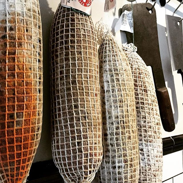 Our Fennel Garlic and Sopressa Salami just hanging out awaiting their Charcuterie destination. #uniquedining #roottoleaves #nosetotail #cookshill #darbyst #smh #goodfoodguide