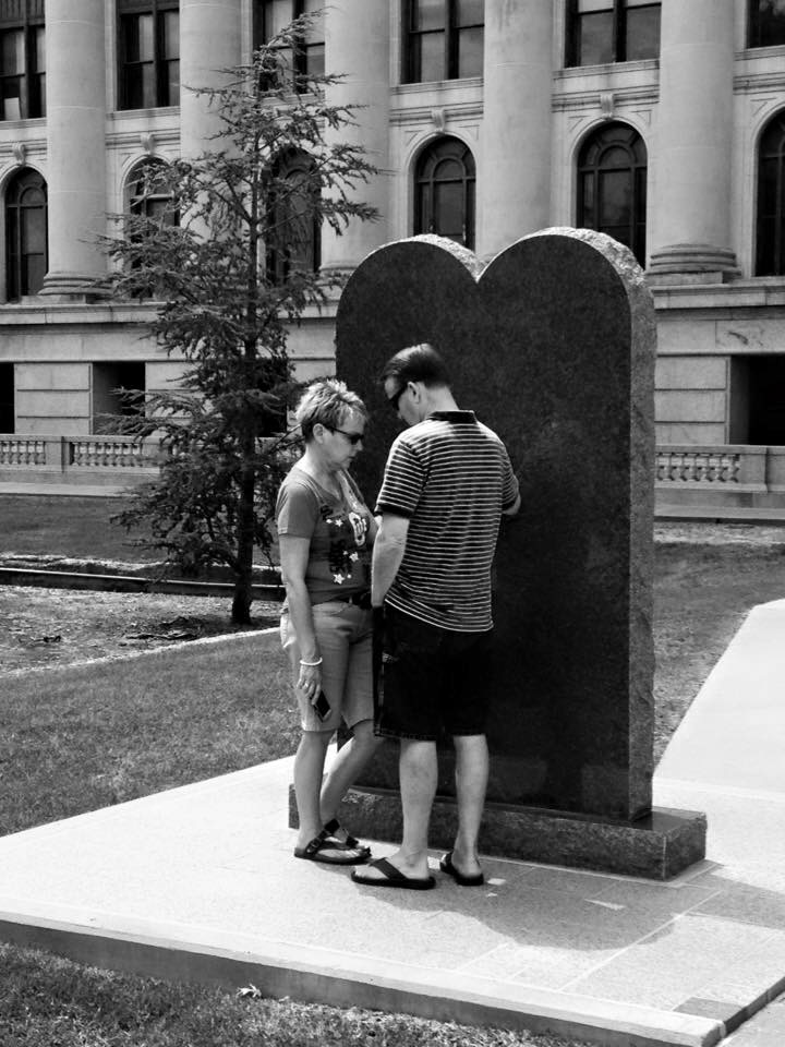 A couple praying at the 10 Commandments Monument in Oklahoma City.  The monument was removed on October 6th the same year, because the Supreme Court ruled it unconstitutional to display a religious monument on Government property.