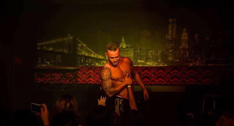 "Our male stripper""Hayden"" getting interactive with the crowd at a stage show in Gold Coast, Australia."