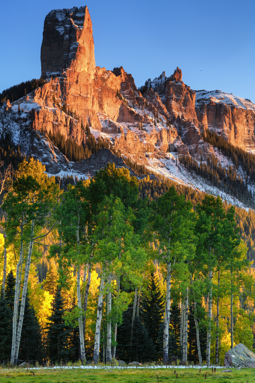 Chimney Rock, in the San Juan mountain range, stands above a grove of aspens.
