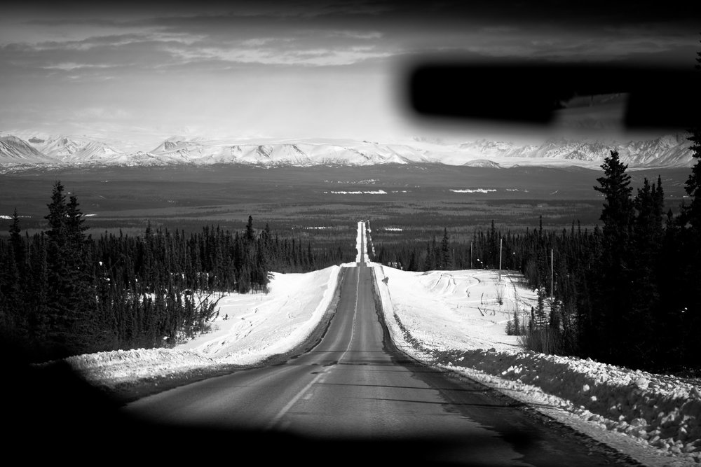 Roads in alaska - they go on forever. Also notice the snowmachine tracks on the side of the roads.