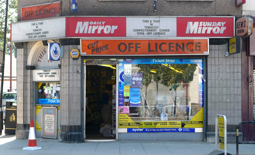 londonshopfronts :     Cut Price Off Licence, Plaistow Road E15     light makes it feel like it could be in a america.