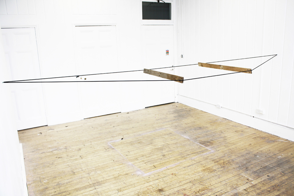 Suspended II, 2012, Elastic cord and Wood