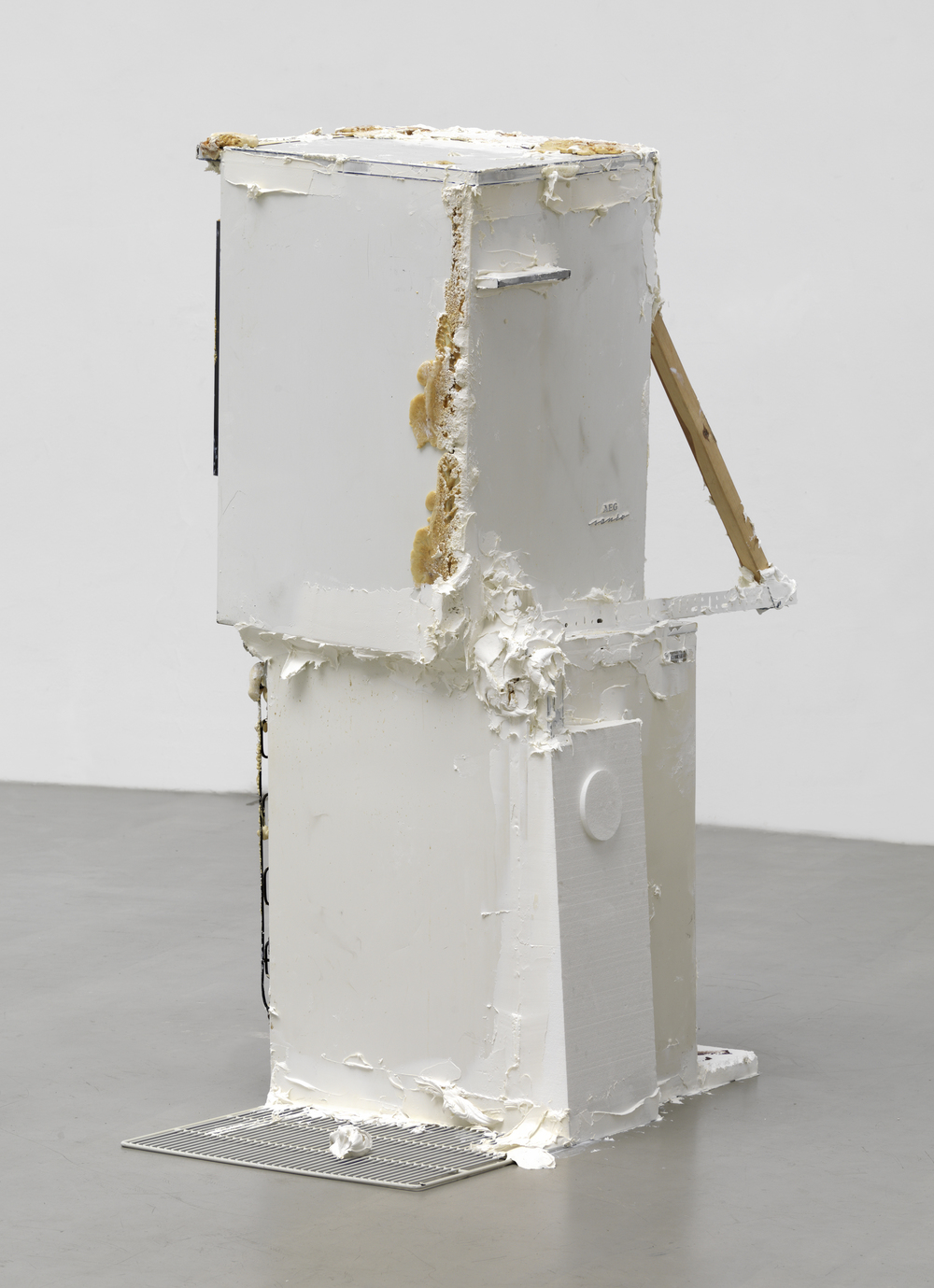 Untitled (version 2), 2014, refrigerators, polyurethane foam, Penaten baby cream, Styrofoam, plastic, wood, wire, chocolate biscuits, Nutella, 175 x 440 x 220 cm