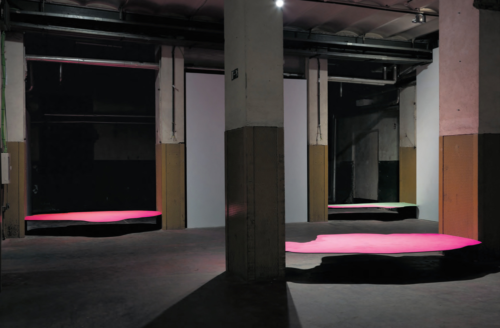 "Una, otra y otra vez a la vez, 2014, site-specific for ""Tabacalera. Espacio para el Arte"" Pieces of wood hold in between two pillars and covered with florescent pigments, variable dimensions"