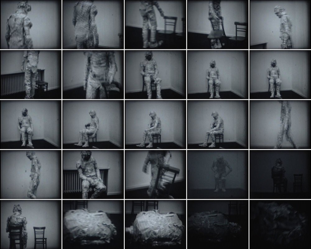 Man Made of Newspaper or the Possibilities for Communication performance at Student's Cultural Centre Gallery, Belgrade, Serbia. 1973, 8 mm, silent movie, b/w movie