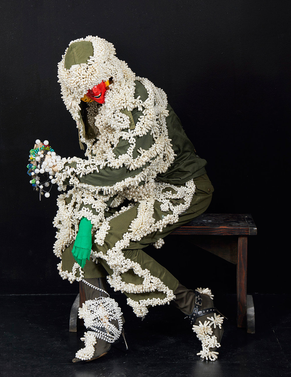 Roll Me in a Grain of Salt and I Follow You until my Tears Run Dry, 2016, military clothing, fake pearls, thread, bullets, mannequin, plastic mask, 121.92 x 81.28 x 63.5 cm