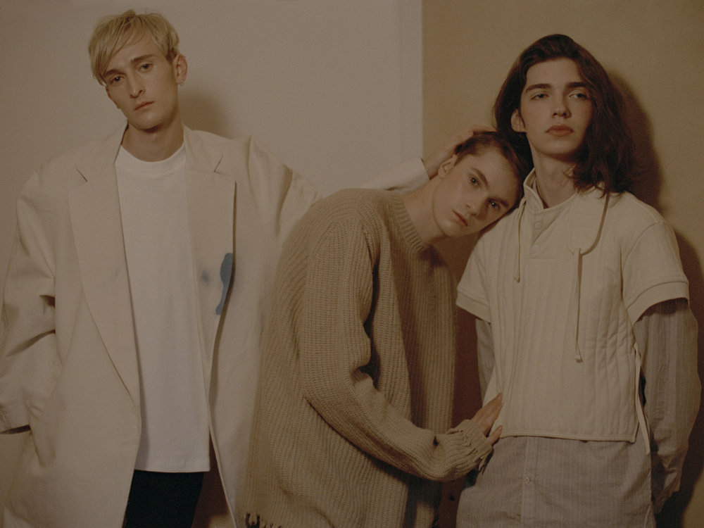 Lewis wears t-shirt   FANMAIL   coat   A-COLD-WALL  . Harry wears sweater   MSGM  . Johnny wears shirt   BEVILACQUA   top   CRAIG GREEN  .