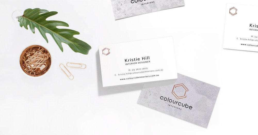 ColourCube Interiors business cards with concrete textures and rose-gold foil finish.