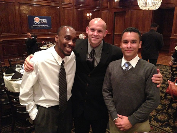 Pictured (from left to right): Charles Smith, MPD officer Robert Corchado and Andy Alvarez.