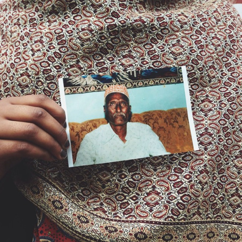 Fatiima with a picture of her grandfather.
